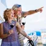 Retired couple on boat drinking wine