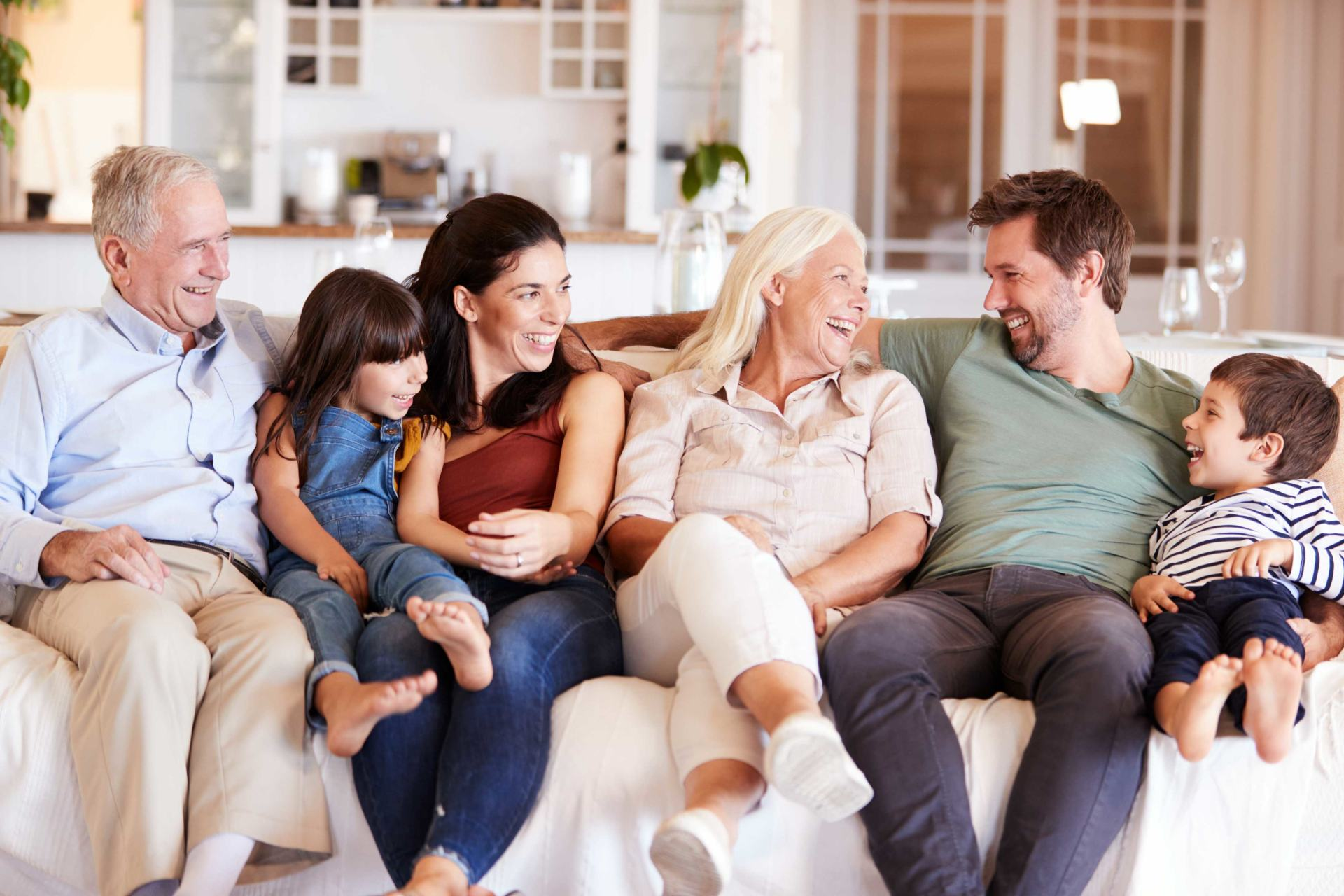 Multi-generation family smiling on couch